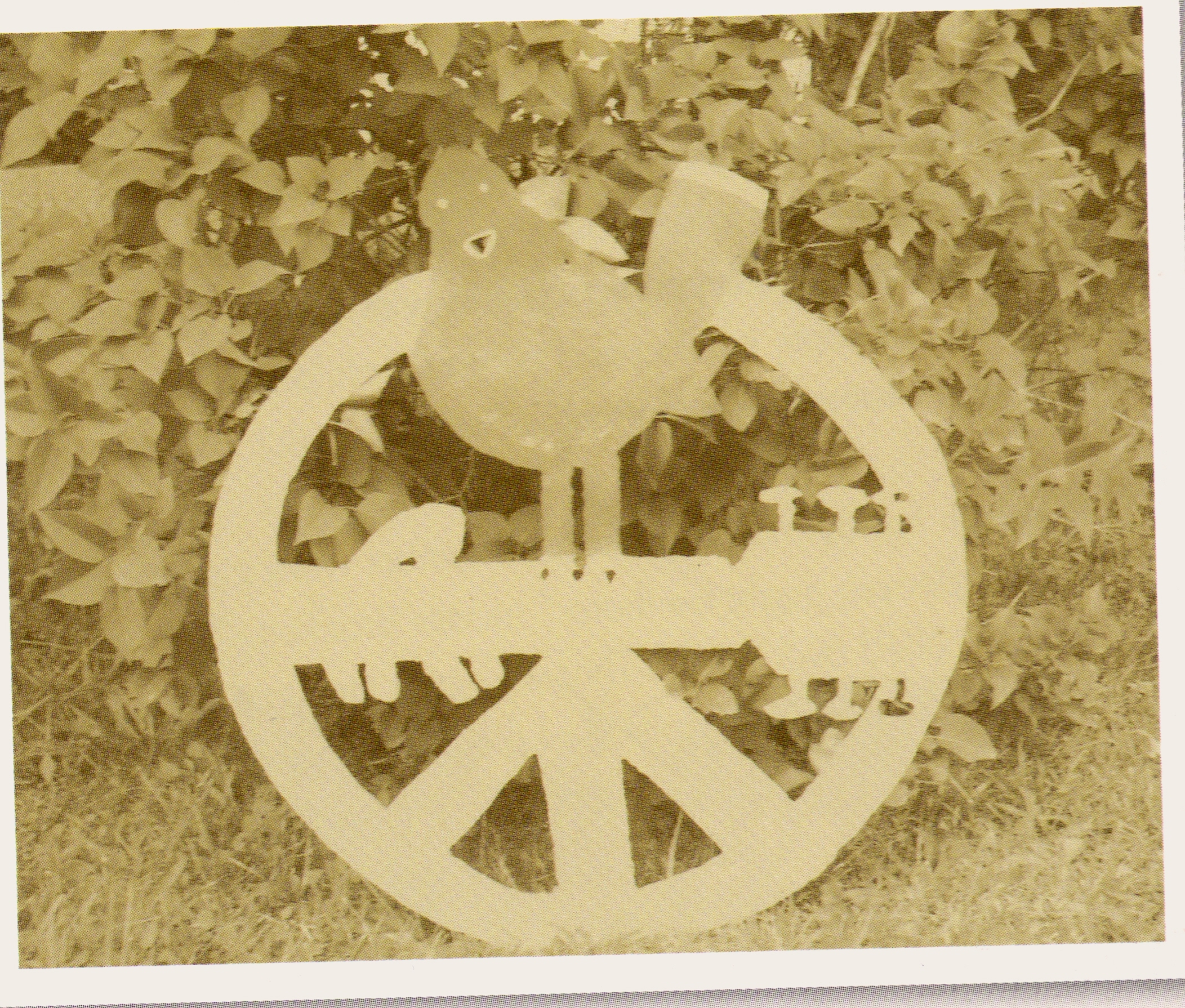 This peace sign and dove cut-out is an exact duplicate of the one originally hand-crafted by Ken VanLoan