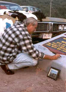 Artie Signing the Woodstock Monument